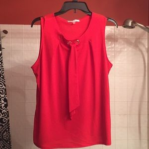 Orange red blouse with gold buttons